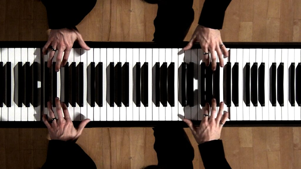 mirrors mirror image of piano hands keyboard nathan shirley